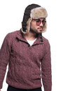 Side view of a young casual man in furry hat looking away from the camera Royalty Free Stock Photography