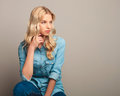 Side view of a young casual woman sitting Royalty Free Stock Photo
