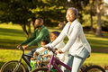 Side view of a young family doing a bike ride Royalty Free Stock Photo