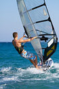Side view of young windsurfer Royalty Free Stock Photo