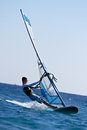 Side view of young windsurfer Stock Photos