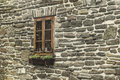Side window of a rural stone house Royalty Free Stock Photo