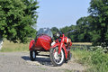 Sidecar old red on the road Royalty Free Stock Photography