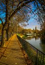 Sidewalk alongside Bega River and The Orthodox Cathedral in Timisoara Royalty Free Stock Photo