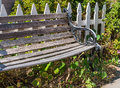 Sidewalk bench invites you to sit and relax Stock Image