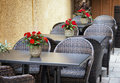 Sidewalk cafe table and chairs at a Stock Photography