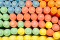 Sidewalk chalk a box full of red purple blue green yellow orange Stock Photo