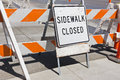Sidewalk close sign is due to construction Royalty Free Stock Photography
