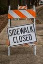 Sidewalk Closed Sign Askew on Stand Full Frame