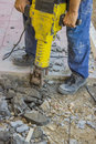Sidewalk crack repairing works with electric jackhammer Royalty Free Stock Images