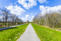 Sidewalk on a levee at the baltic sea under blue sky Royalty Free Stock Photo
