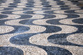 Sidewalk traditional portuguese cobblestone pattern on a Royalty Free Stock Image