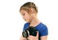Sideways glance cute little girl holding big digital camera studio shot Royalty Free Stock Image
