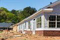 Siding and windows on new row house construction in a neighborhood Stock Image