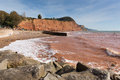 Sidmouth beach coast devon england uk with a view along the jurassic coast september th late summer september sunshine and warm Royalty Free Stock Image