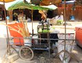 Street vendor is squeezing sugar cane juice Royalty Free Stock Photo