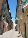 Siena before the palio italy streets of decorated with contrades flags Stock Photo