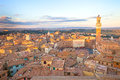 Siena sunset panoramic skyline. Mangia tower landmark. Tuscany, Stock Photography