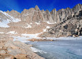 The sierra crest over frozen lake mount whitney on main trail at trail camp Stock Photos