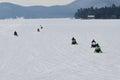 Siete motos de nieve en el lago agradable Imagenes de archivo