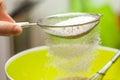 Sieving flour Royalty Free Stock Photo