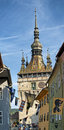 Sighisoara clock tower and street detail at medieval festival Royalty Free Stock Image