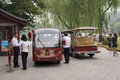 Sight seeing cars in beihai park pictures of the trolley is beijing sightseeing car tourists can take a car to the north sea all Royalty Free Stock Image