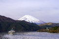 Sight seeing ship on Hakone Lake with Fuji mountain background, Royalty Free Stock Photo