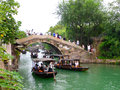 Sightseeing boat from ancient town boating on the lake through a stone bridge inside wu zhen west gate scenic spot tongxiang city Royalty Free Stock Photos