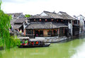 Sightseeing boat and buildings from ancient town boating on the lake near the inside xitang view jiashan county jiaxing city Royalty Free Stock Images