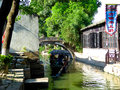 Sightseeing boat in luzhi ancient town sailing on the river through lu zhi residence community suzhou city jiangsu province china Stock Images