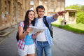 Sightseeing couple of travelers with map in ancient town Stock Photo