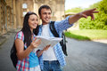 Sightseeing couple of travelers with map in ancient town Royalty Free Stock Image