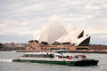 Sightseeing cruise coming into the circular key sydney australia july sydney opera house in background Stock Photos