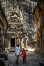 Sightseeing ellora cave indian father and son inside the enormous jain temple carved out of a giant solid rock in india Royalty Free Stock Photography