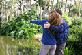 Sightseeing on florida vacation father and teenage daughter vacationing in and visiting a cypress swamp nature preserve Stock Photography