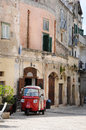 Sightseeing in matera sassi di south italy you can make private a little three wheeled car like a vespa motorbike is Stock Images