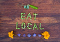 "Sign ""Eat Local"" made of green peas and pea pod Royalty Free Stock Photo"