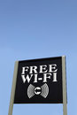 Sign Advertising Free Wi-Fi Against Blue Sky Royalty Free Stock Photo