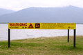 Sign on beach warning of danger from crocodiles