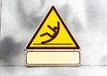 Sign beware slippy on wall in toilet Stock Image