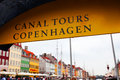 Sign canal tours in copenhagen and row of buildings danmark Stock Photos