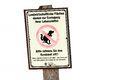 Sign for dog holders on agricultural usable areas Royalty Free Stock Image