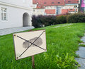 Sign: don`t walk on the grass. Prohibitions in our lives Royalty Free Stock Photo