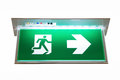 Sign of emergency exit green showing the way to escape Royalty Free Stock Images