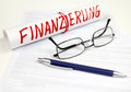 Sign financing with glasses and pen Royalty Free Stock Photo