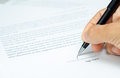 Sign here a hand signing a document Royalty Free Stock Photography