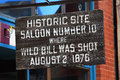 Sign for historic site in deadwood south dakota closeup of showing where wild bill hickok was killed Stock Photo