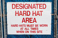A sign indicating that you are in a designated hard hat area Stock Images