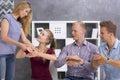 Sign language teacher correcting her students